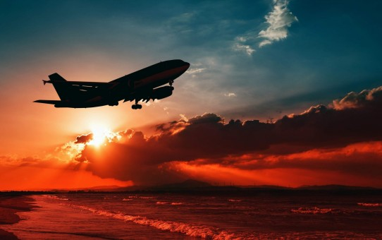 plane-flying-over-sea-4k-wallpaper-1920x1080